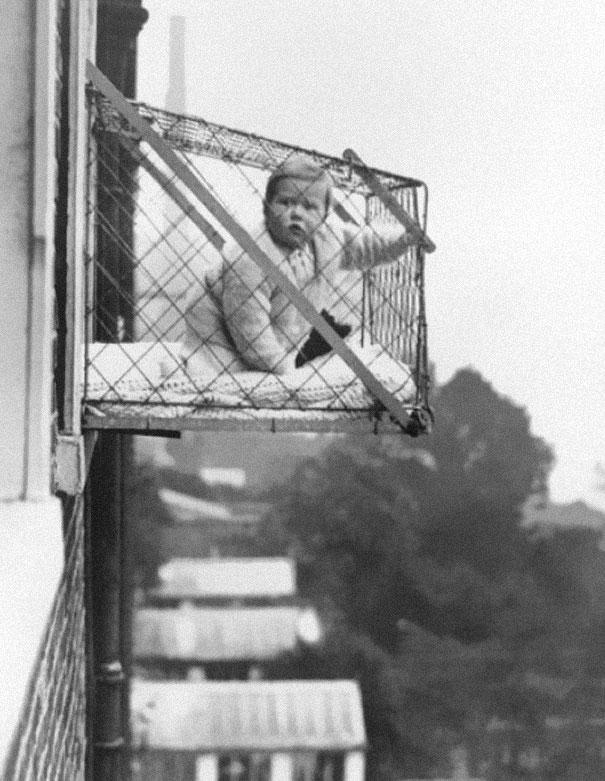 Baby-cages-used-to-ensure-that-children-get-enough-sunlight-and-fresh-air-when-living-in-an-apartment-building-ca-1937